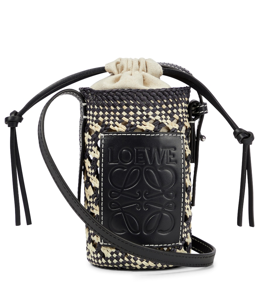 Cylinder leather-trimmed raffia crossbody bag