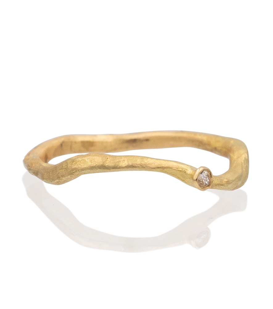 Solitaire 18kt gold ring with diamond