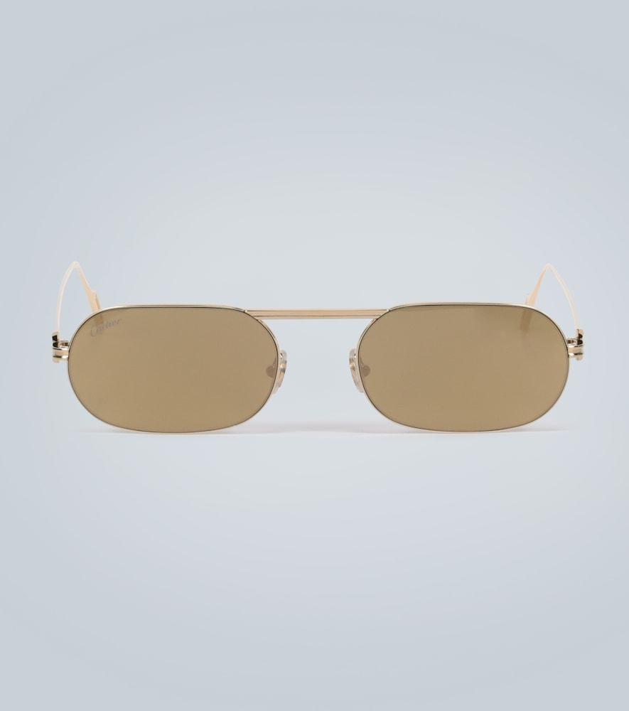 Lunettes de soleil ovales - Cartier Eyewear Collection - Modalova