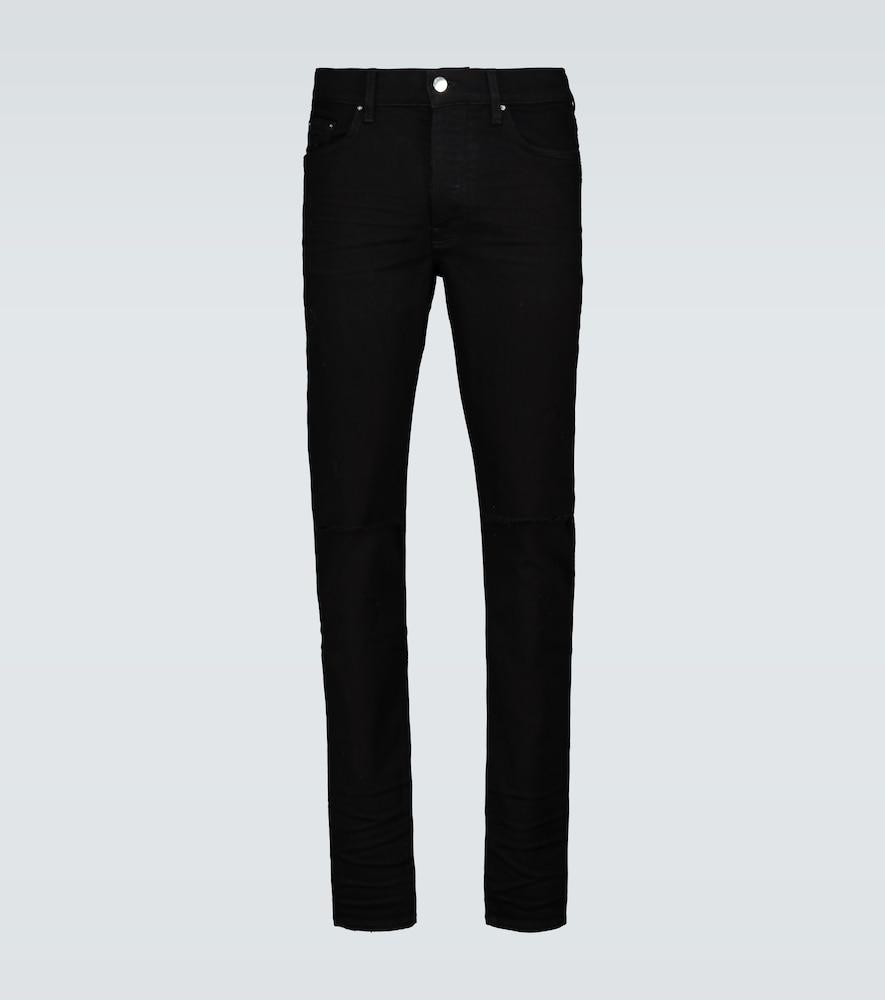 Amiri 'slash' Distressed Knee Skinny Jeans In Black