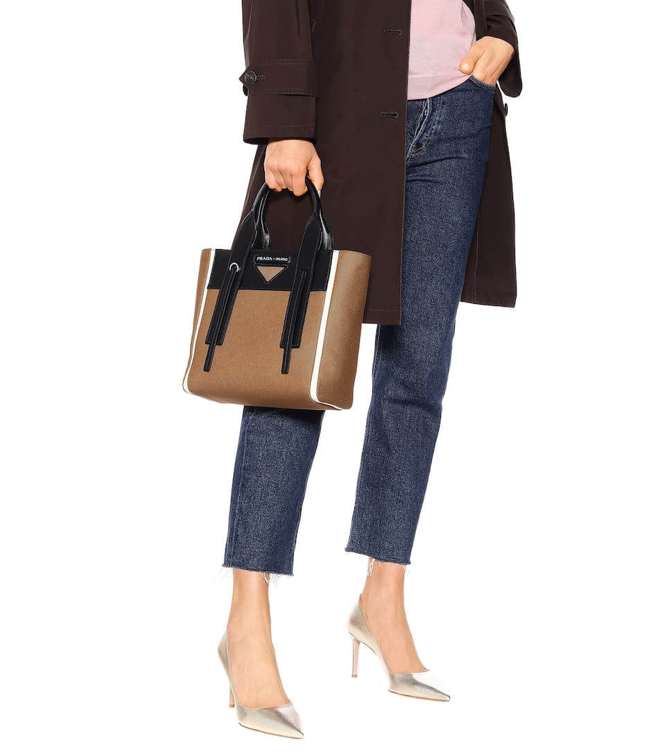 f577c3bc5404 Ouverture Small leather-trimmed tote. Prada
