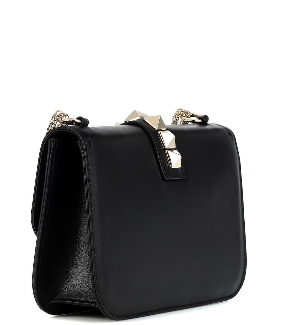 lock medium leather shoulder bag valentino mytheresa. Black Bedroom Furniture Sets. Home Design Ideas