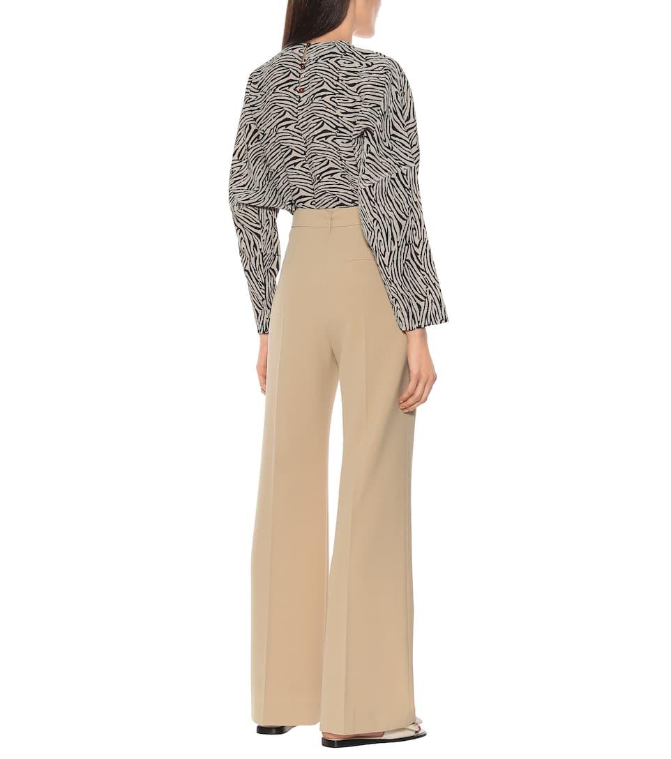 Nanushka - Clara belted high-rise flared pants