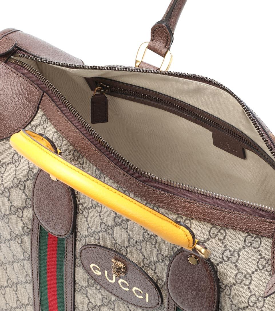 amazone Pas Cher Finishline Gucci - Sac de voyage à finitions en cuir GG Supreme inUPM