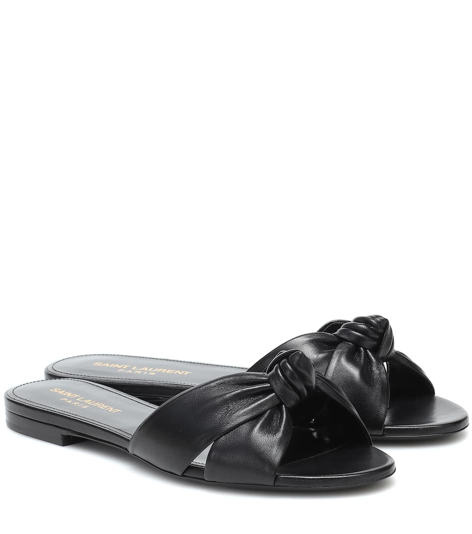 Bianca leather slides by SAINT LAURENT, available on mytheresa.com for $595 Angelina Jolie Shoes Exact Product