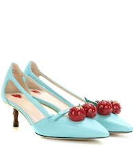 Cherry patent leather pumps