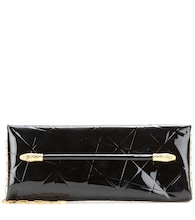 East West Snake Heads patent leather clutch
