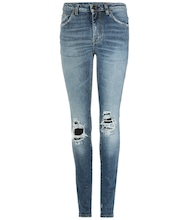 Distressed skinny jeans with leather