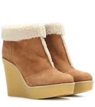 Suede and shearling wedge ankle boots