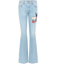 Flared jeans with embroidered appliqué