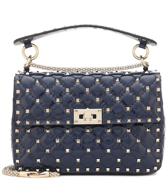 Valentino - Valentino Garavani Rockstud Spike Medium patent leather shoulder bag - mytheresa.com
