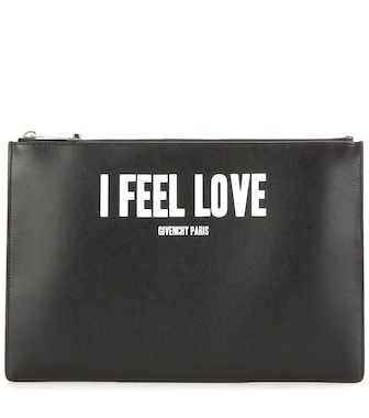 Givenchy - Iconic Print leather clutch - mytheresa.com