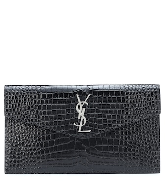 Saint Laurent - Uptown embossed leather clutch - mytheresa.com