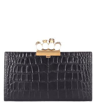 Alexander McQueen - Skull Four-Ring leather clutch - mytheresa.com