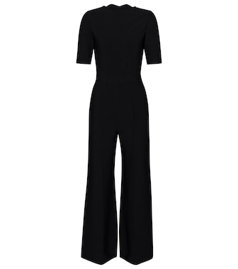 Alaïa - Stretch-knit flared jumpsuit - mytheresa.com
