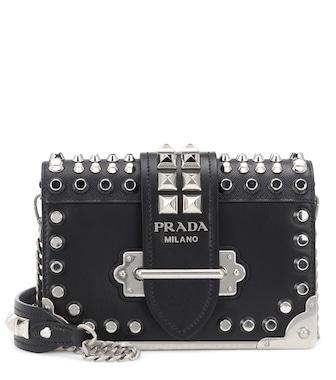 b7579da648f7 Prada - Cahier studded leather shoulder bag - mytheresa.com