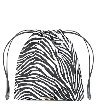 Miu Miu - Leather-trimmed drawstring pouch - mytheresa.com