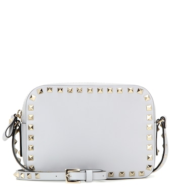 Valentino - Valentino Garavani Rockstud leather cross-body bag - mytheresa.com