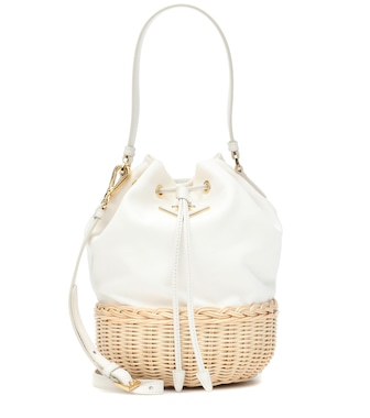 Prada - Canvas and wicker bucket bag - mytheresa.com