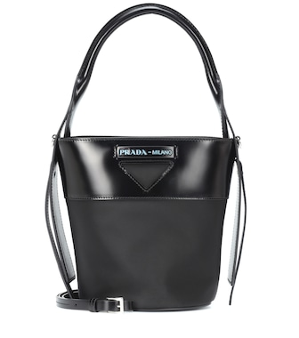 Prada - Leather-trimmed nylon bucket bag - mytheresa.com