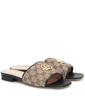 Gucci - GG leather-trimmed canvas slides - mytheresa.com