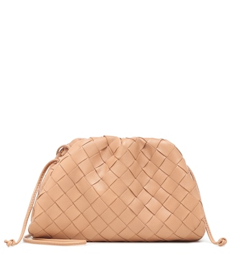 Bottega Veneta - The Mini Pouch leather clutch - mytheresa.com