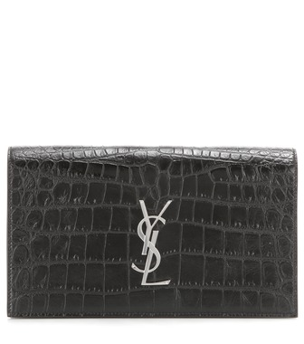 Saint Laurent - Classic Monogramme embossed leather clutch - mytheresa.com