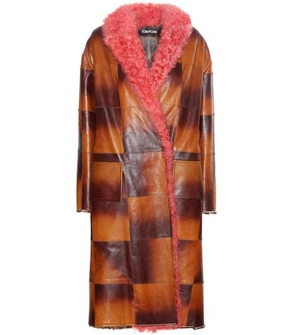 Fur-trimmed leather coat