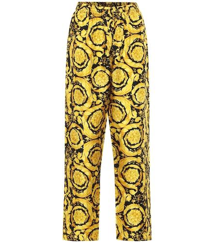 Pantalon imprimé en soie - Versace - Modalova