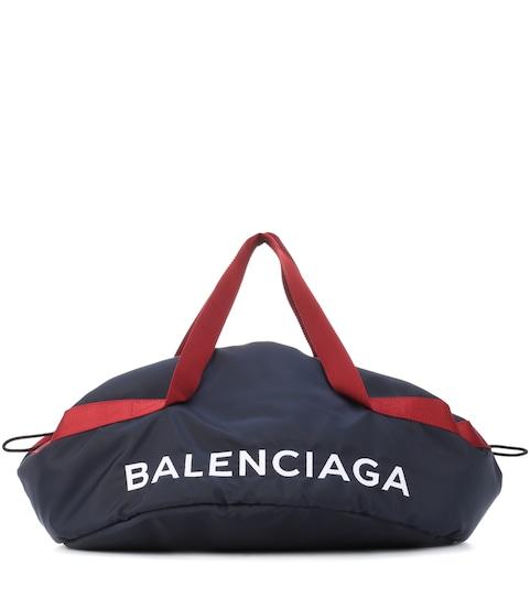 a64ccbeda29f7 حقيبة من الكانفا مع تزيين - Balenciaga
