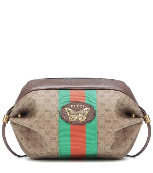 8611cef182d4 Mini GG leather-trimmed shoulder bag | Gucci