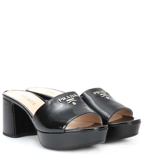 0267f6fba7354a Prada Logo Leather Sandals from mytheresa - Styhunt