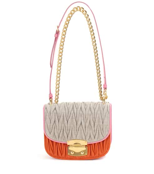 Miu Miu Canvas And Leather Shoulder Bag from mytheresa - Styhunt 8cf5a3533c213