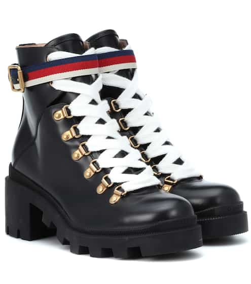 472a8a2fdd2 Gucci Sylvie Web Leather Ankle Boots from mytheresa - Styhunt