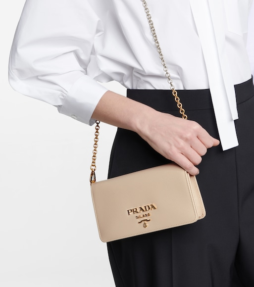 Prada - Leather crossbody bag - mytheresa.com