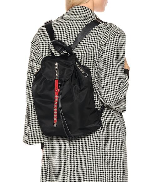4bed84a811e6 Prada - Embellished nylon backpack - mytheresa.com